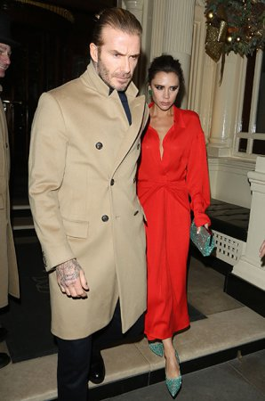 Виктория и Дэвид Бекхэмы на рождественской вечеринке в Лондоне